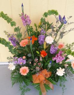 lavender, peach, and orange wicker basket arrangement
