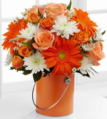 Orange Paint Can filled with fresh flowers
