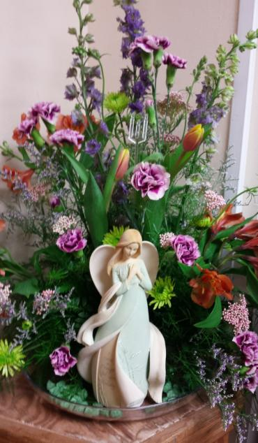 Angel with fresh flowers